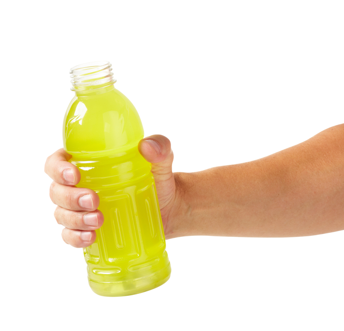 Hand holding sports drink, larger files come with clipping path.